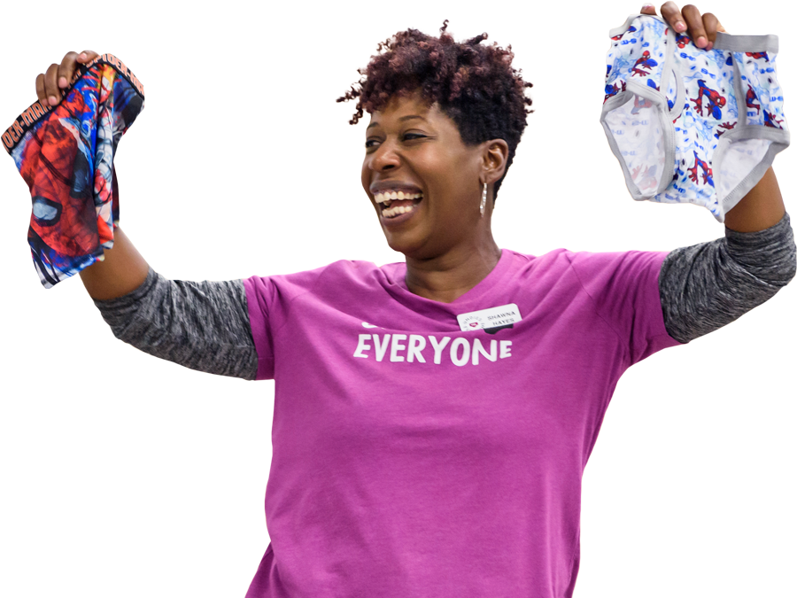 happy woman holding up colorful kids underwear